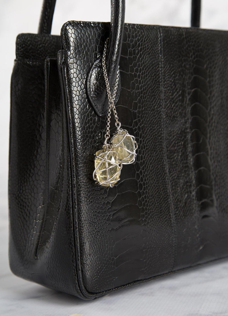 Black Ostrich Leg Blair Open Tote close up of citrine silver fob - Darby Scott
