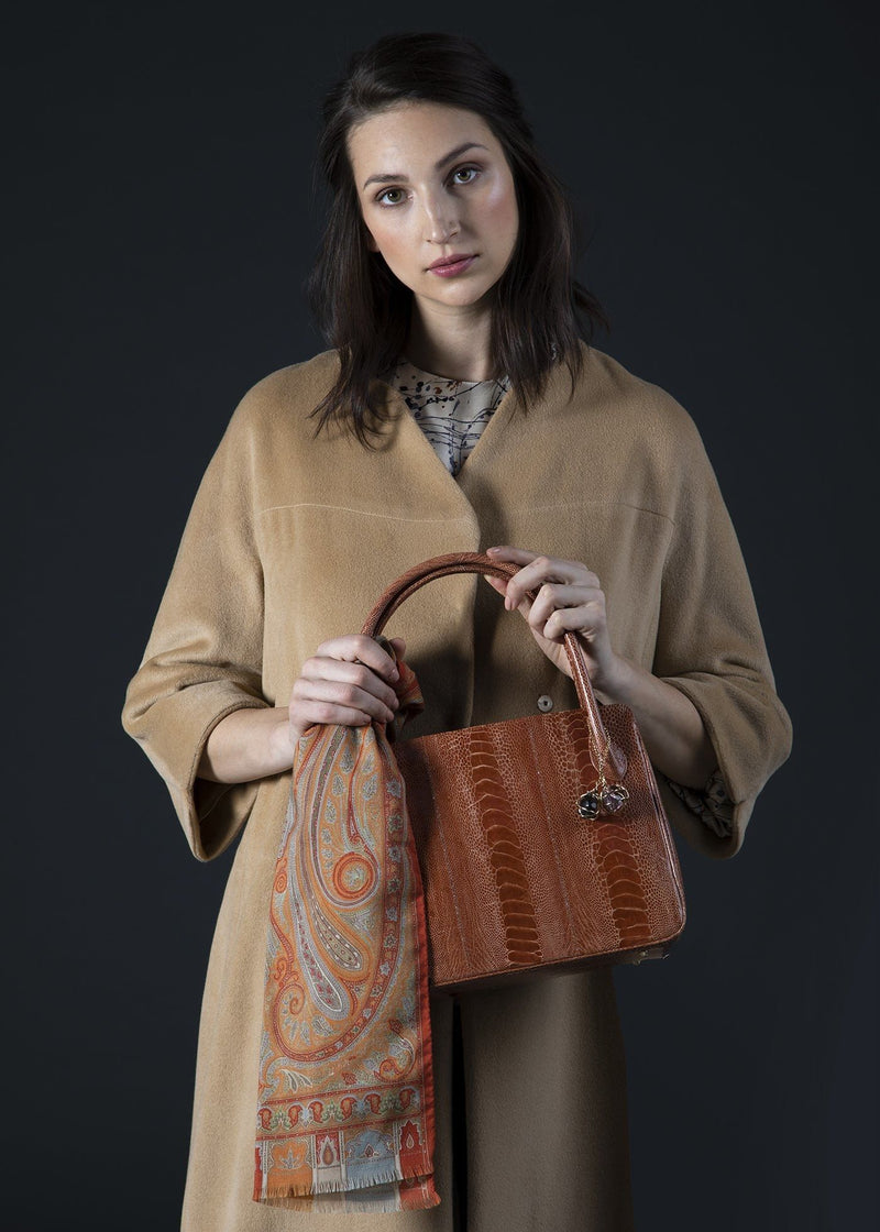 Orange Ostrich Leg Blair Open Tote Held by model- Darby Scott