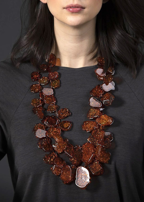 Model wearing faux amber necklace set - Darby Scott