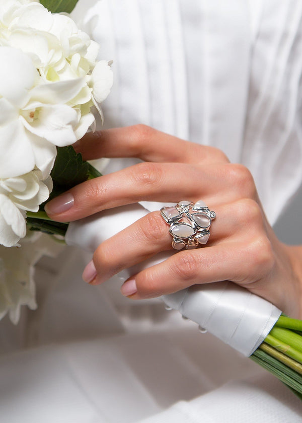 Moonstone & Diamond Sterling Cocktail Ring shown on hand of model holding a bouquet - Darby Scott--alternate