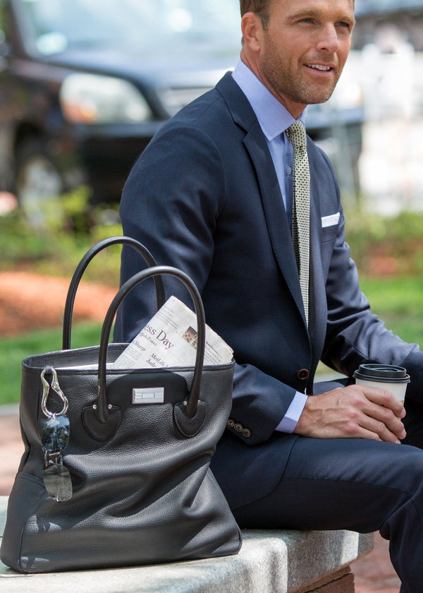 Model with black leather Essex tote beside him - Darby Scott