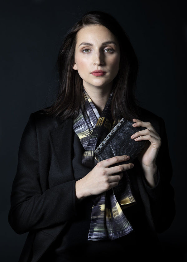Model in Abstract Plaid Silk Scarf with a black python art deco clutch - Darby Scott