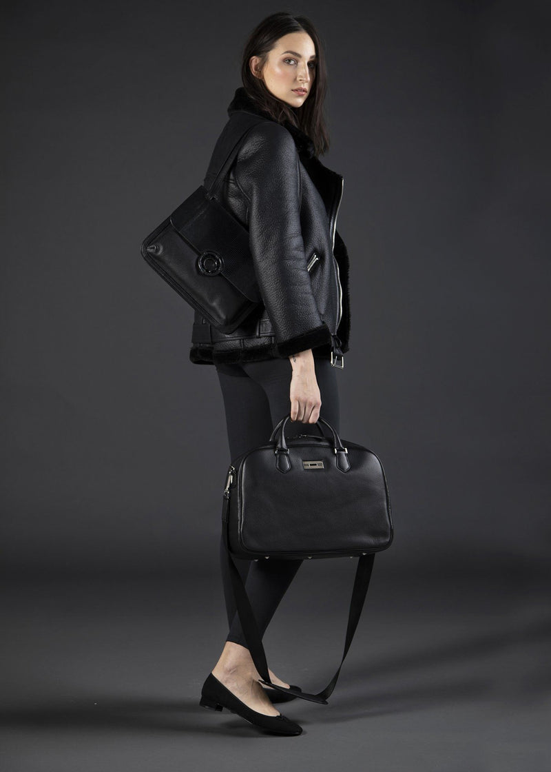 Model with Black Leather Newport Getaway Bag - Darby Scott