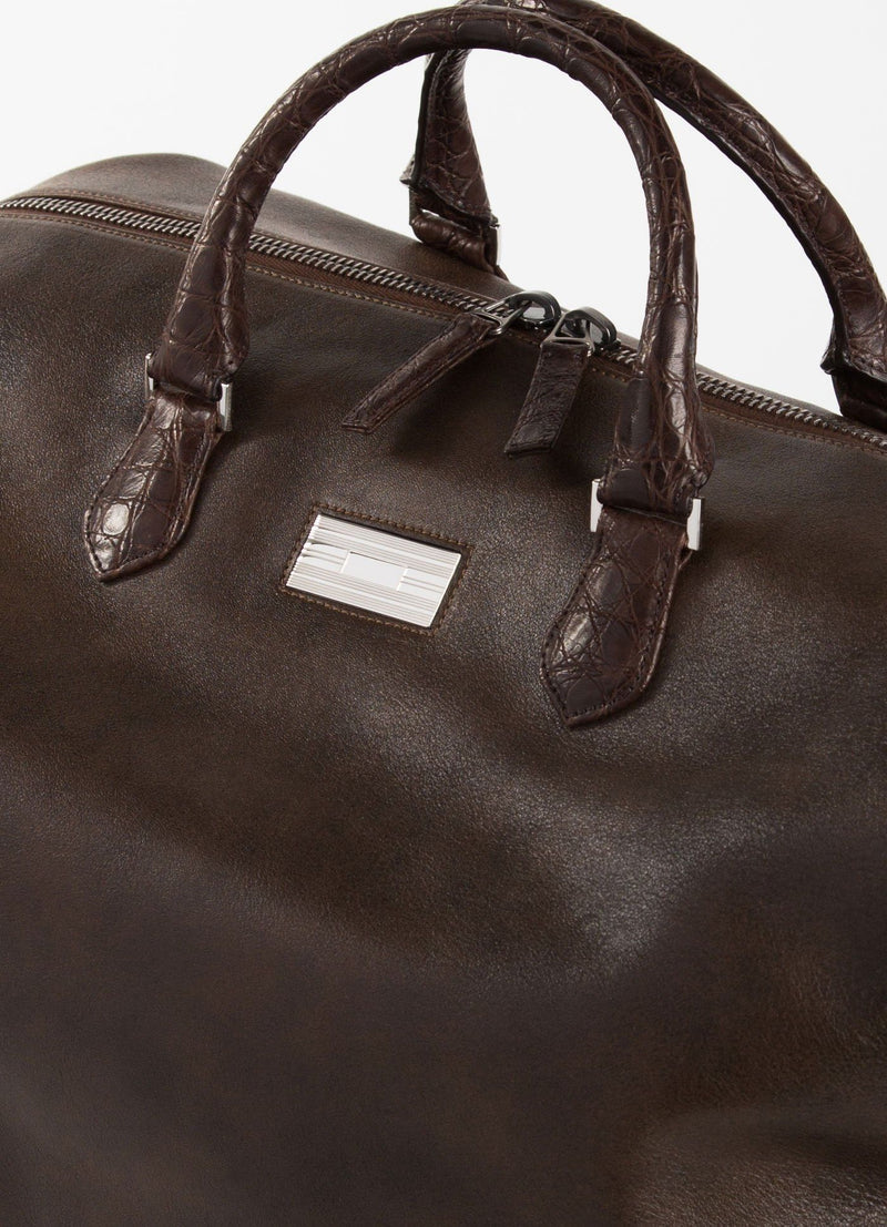 Close up of Sterling monogram plate Brown Aspen Travel Bag With Croc Trim - Darby Scott