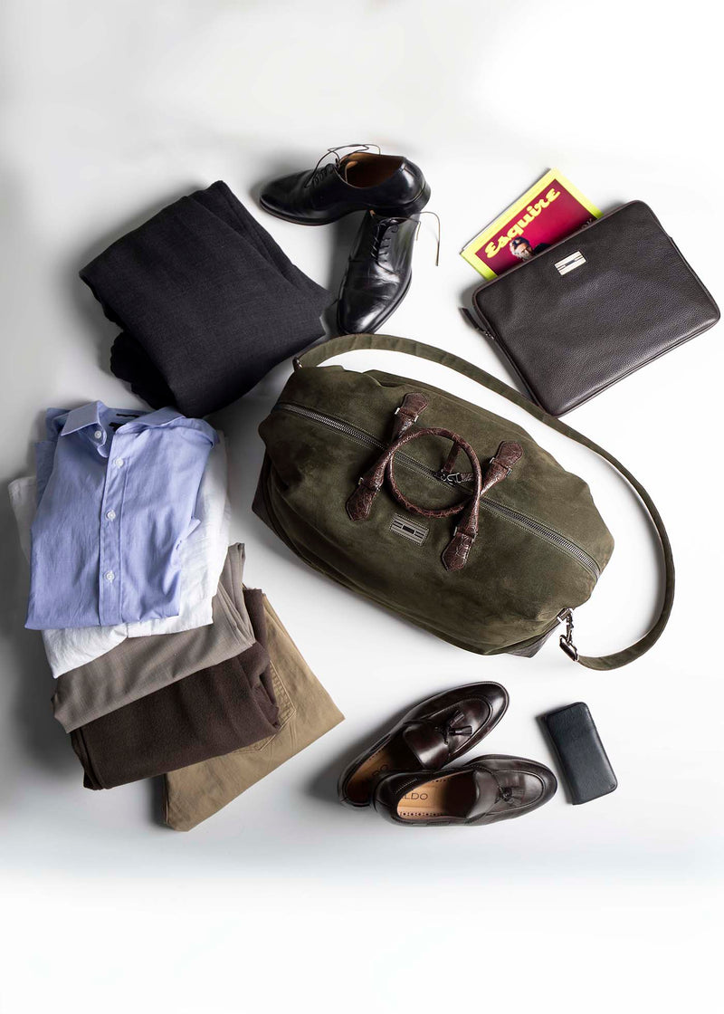 An array of items ready to pack in Aspen Duffel Bag - Darby Scott