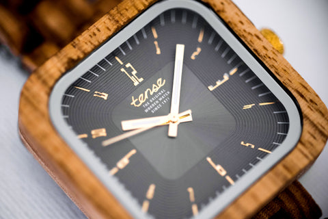 Title: The Appeal of Square Watches Tense Watches | Blog Post  From a wedding ring to a wrist watch, an accessory should reflect your individual personality. If you are investing in an accessory, it should be reliable, fashionable and versatile - but it should not be boring. On the surface, face shape might seem like a small detail but when it comes to wrist watches, angles add edge!   For decades, round watch faces have dominated the industry, because that is what consumers are used to. Just because something is traditional does not mean that it is right for you and your style. As square watches begin to take the fashion world by storm, it is hard not to see the appeal of these eye-catching timepieces.      Square Watches: Breaking Away From the Norm    It is no secret that the original portable timepiece, the pocket watch, was round. These simple shapes were designed for easy retrieval from pockets and were usually held by a chain, this may have been a great tool while on the ground but for pilots, the act of shuffling to see the time was very inconvenient. It was because of this that famous designer Cartier created an aviation-friendly style of watch - and the square watch face was born.   Round watch faces are still popular and functional options for certain scenarios, particularly when it comes to the sporting world. Diving watches, for example, are made round because that shape is easiest to secure against water leakage. This is great, but just because an accessory is practical, does not mean that it has to be common and that is where watch faces can set you apart.      Function: Square faces are a way to add a bit of personality and a unique twist to a practical accessory but even the sharpest angles don't make a difference to functionality. Some might think that adding a unique shape to a wrist watch might impact surface area but this isn't the case. Not only do square faces have the same amount of space as their round counterparts, they are able to house th
