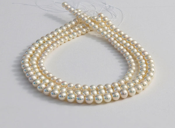 Metallic White Triple Strand Strand of Freshwater Pearls