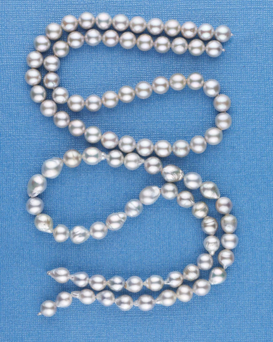 Two strands of Red Sea cultured pearls, one baroque and one round