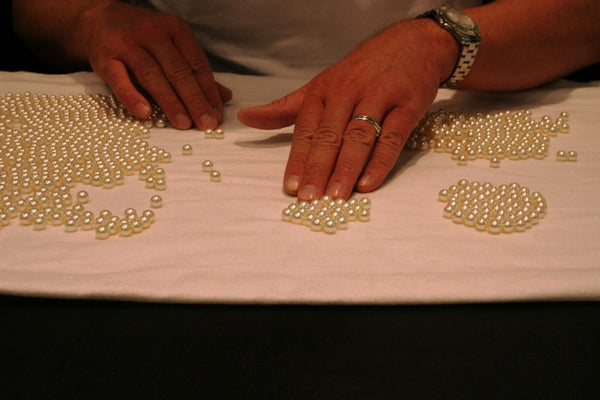 Sorting the South Sea pearls by color