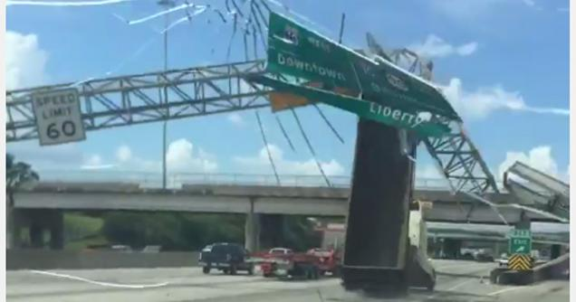 Dump Truck Takes Out Freeway Sign Going Full Speed