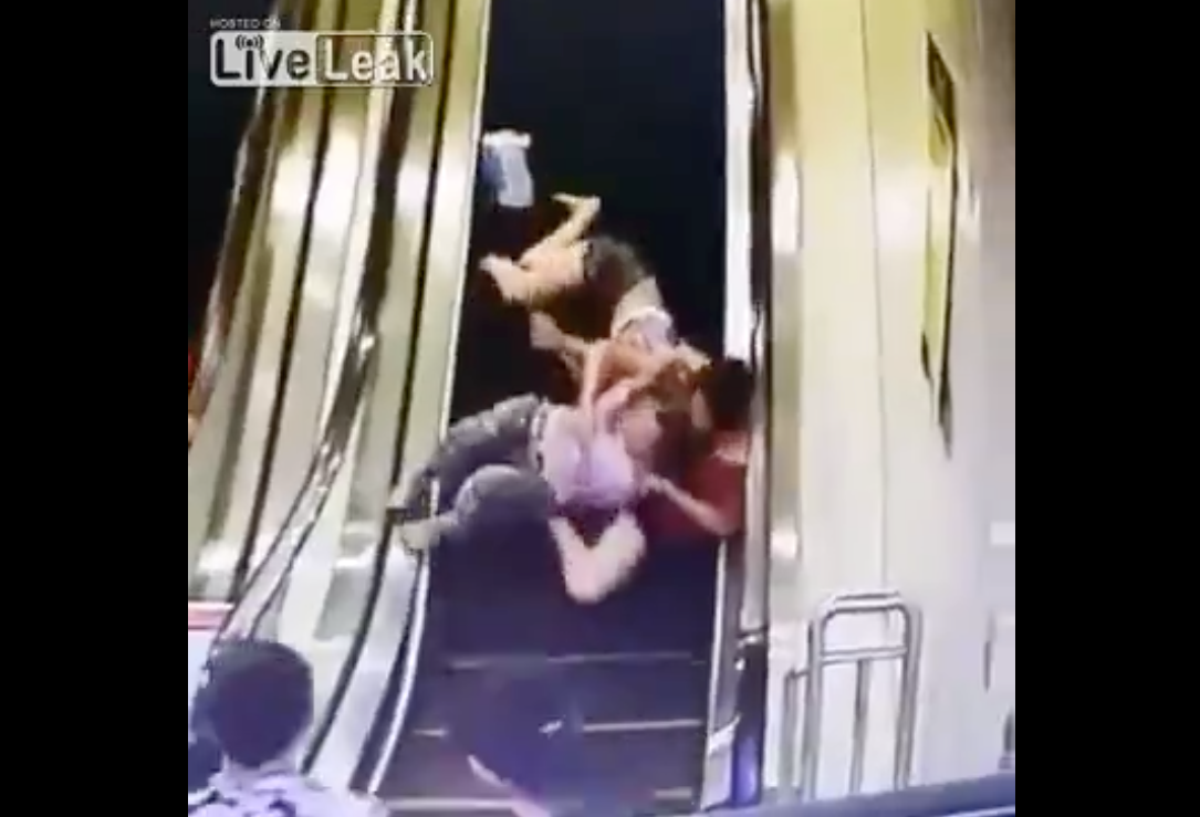 Shocking Moment!-Several women roll helplessly upside down on an escalator!