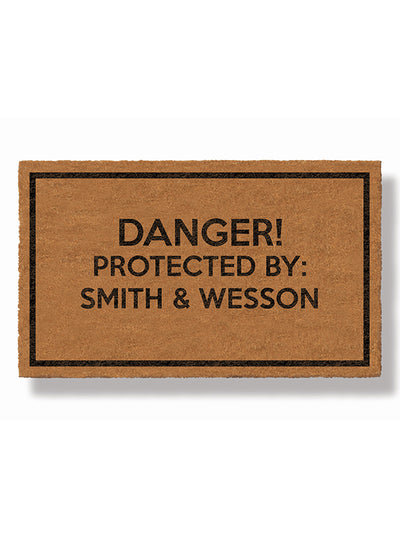 DANGER: Protected by Smith & Wesson Doormat by Funny Welcome