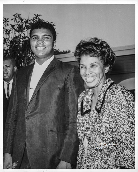 Icons and people - Muhammad Ali smiling with Lorraine Adams, Los Angeles, Aug 1964