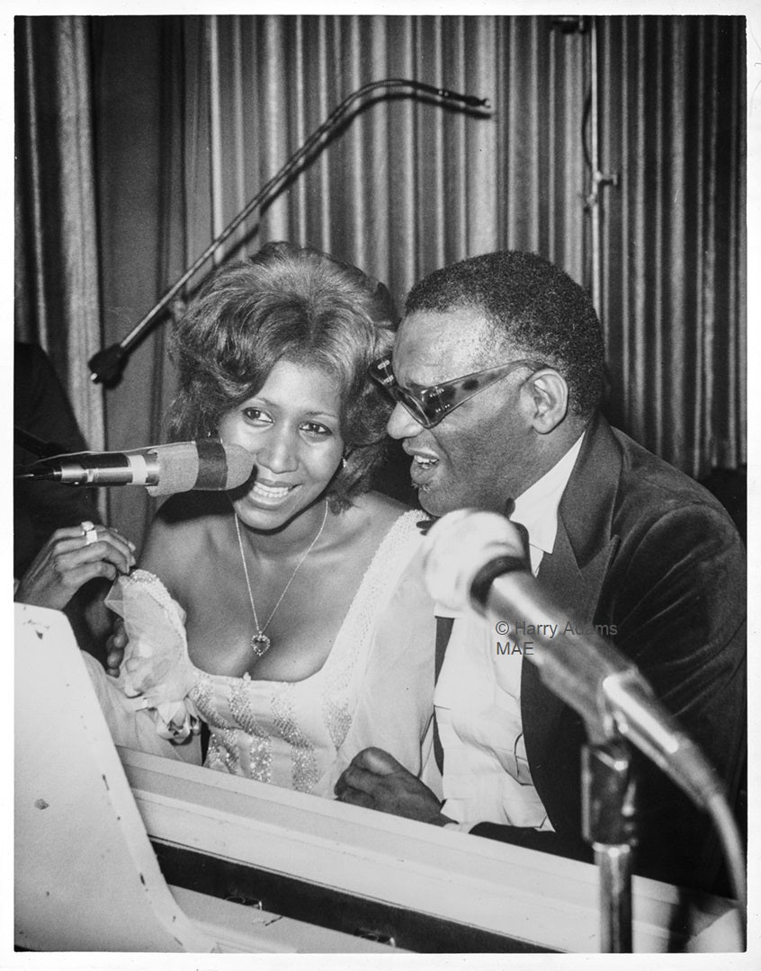 Icons and people -  Music Legends Aretha Franklin & Ray Charles share a laugh, June 1975