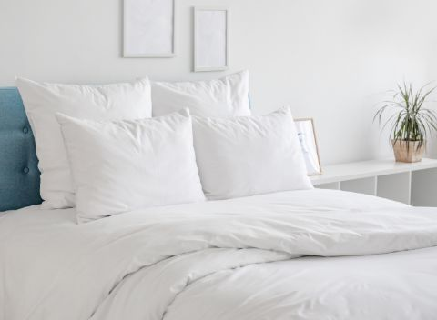 White Bed with white pillows and comforter