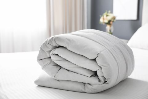 Rolled up white comforter