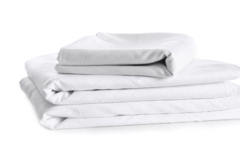 Stack of white cotton sheets