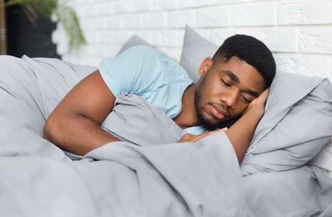 A man sleeping peacefully on his side