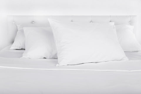 clean pillows neatly placed on a bed