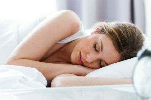 Woman sleeping comfortably on a pillow