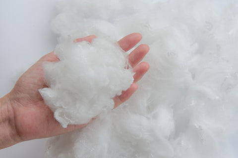 Woman's hand holding Polyester stable fiber pillow fill