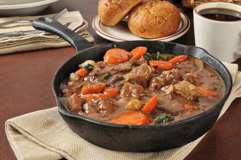Beef Bourguignon: beef stew cooked in red wine with vegetables.