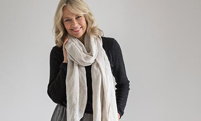 Woman wearing cashmere jumper and Natural Linen Scarf