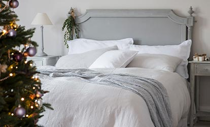 Linen Bed Linen and Christmas Tree on Christmas Morning