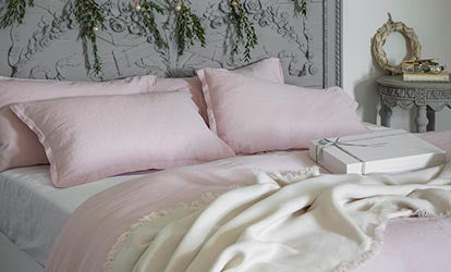 Rose Pink Linen Bed Linen with festive garlands, wreath and Linen Throw