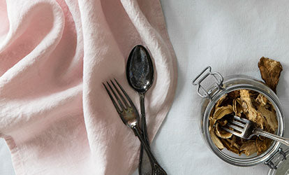 Rose Pink Linen Tea Towel with Cutlery and Dried Mushrooms