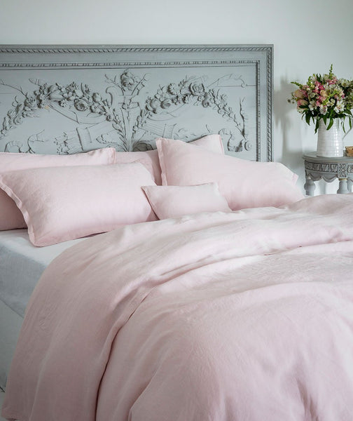 mireille rose pink linen duvet cover with pillowcases and bedside table flowers)