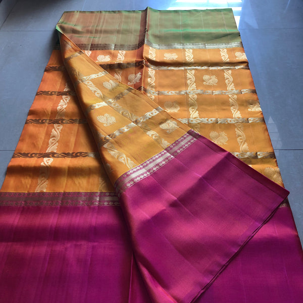 Traditional mayil checked soft silk saree