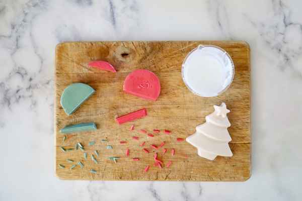 cutting red and green soap into small pieces that look like sprinkles
