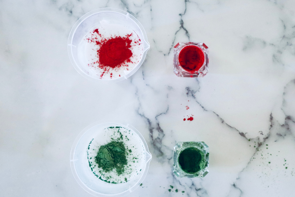 red and green mica powder being added to white soap base
