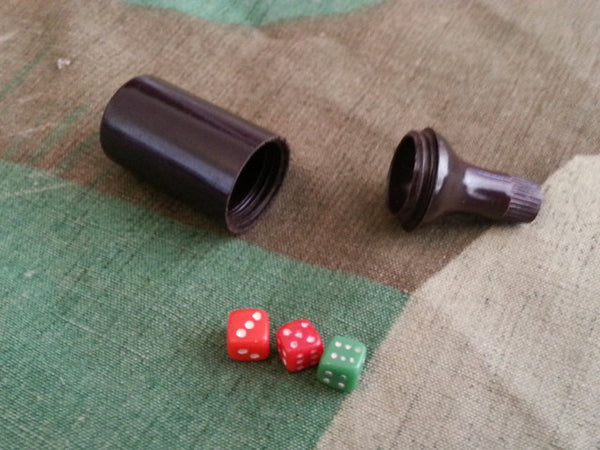 WWII-era German Tiny Dice in Bakelite Bottle