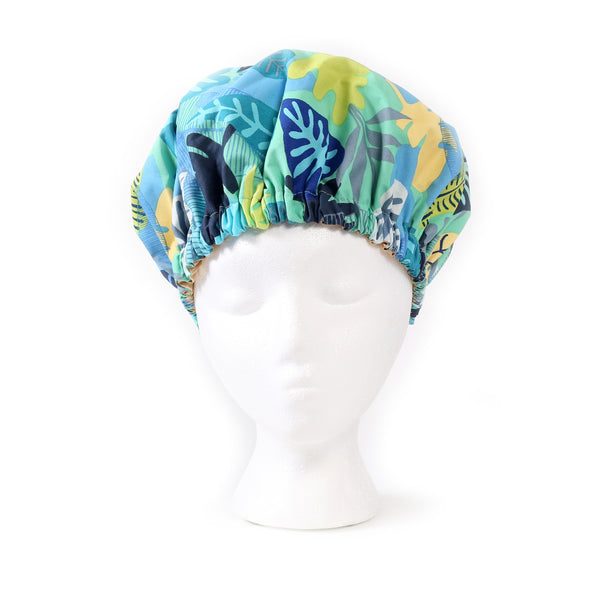 Front view: Aqua Blue Foliage Print Satin Sleep Bonnet