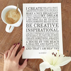 cappuccino on a desk with white flower - vision board