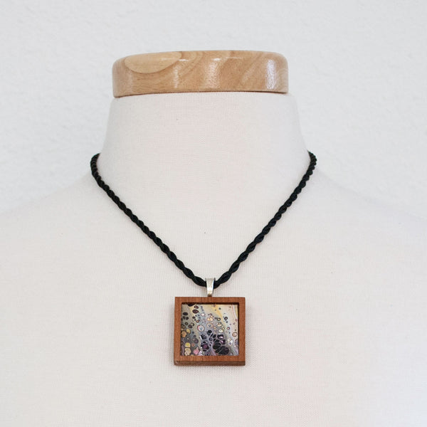 Art Necklace, teal and orange painting in hardwood frame