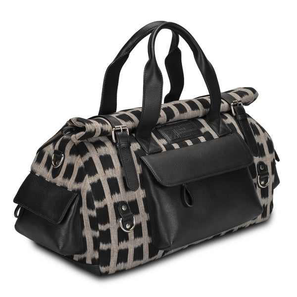 Duffle/Travel/Weekender bag in black color pebble grain leather, cotton ikat body fabric/canvas and burgundy cotton lining