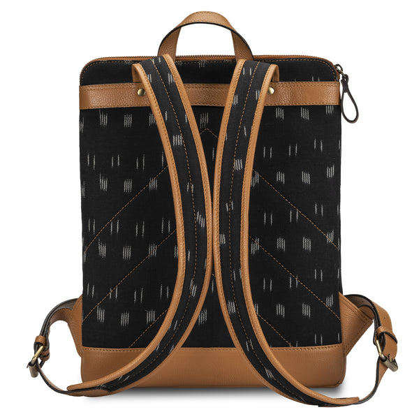 Backpack in tan color pebble grain leather and black Ikat cotton fabric/canvas