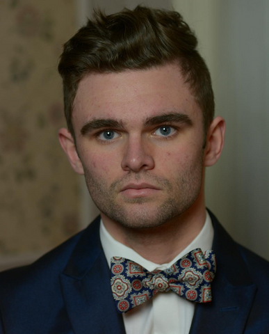 Connor Blake wearing our bow ties to stand out within the real estate industry!