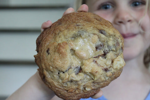 One of my kids with a huge kitchen sink cookie
