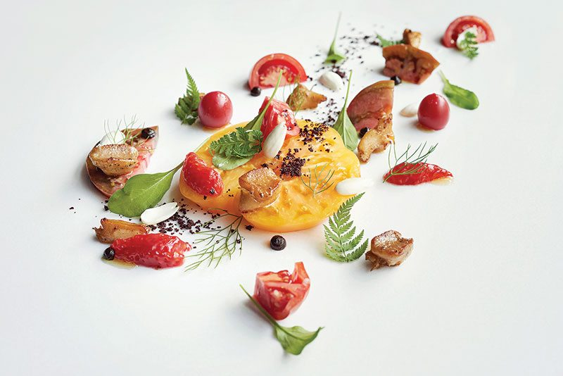 restaurant toqué! dish tomates with garnish and strawberries
