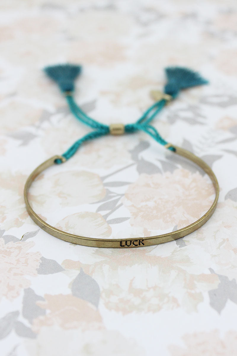 SALE! Goldtone 'Luck' Bar Teal Tassel Cord Cuff Slider Bracelet