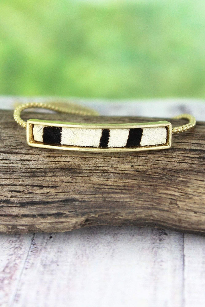 Crave Zebra and Goldtone Bar Bolo Bracelet