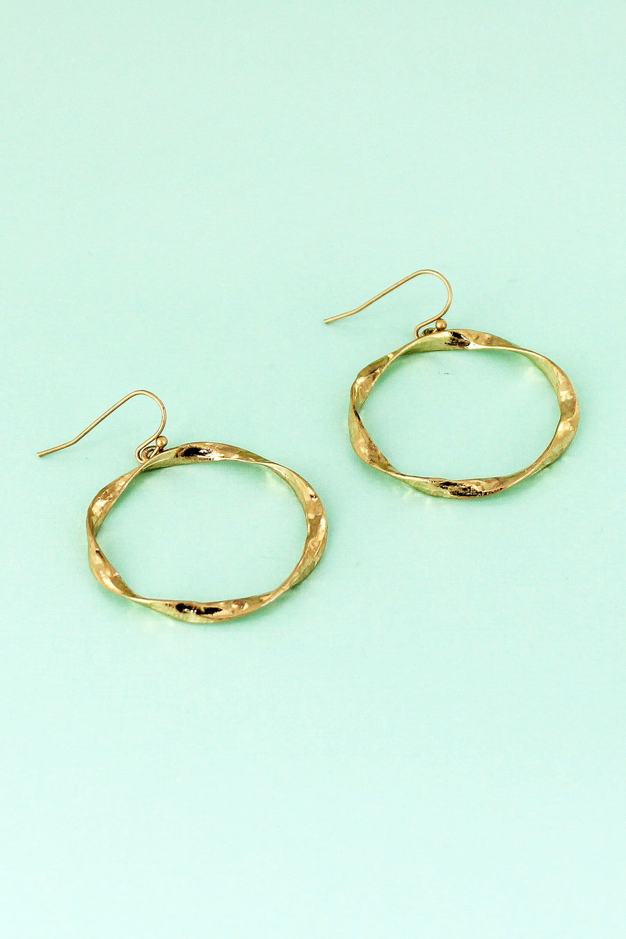 Crave Worn Goldtone Twisted Circle Earrings