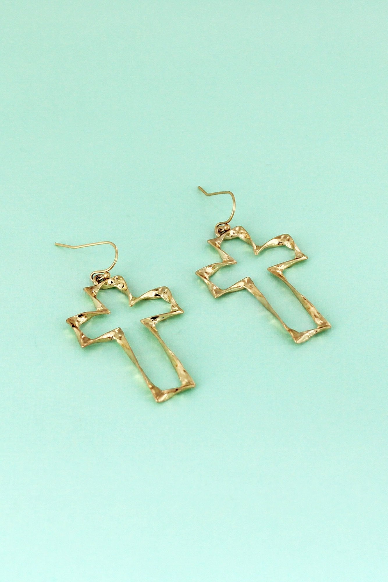 Crave Worn Goldtone Twisted Cross Earrings