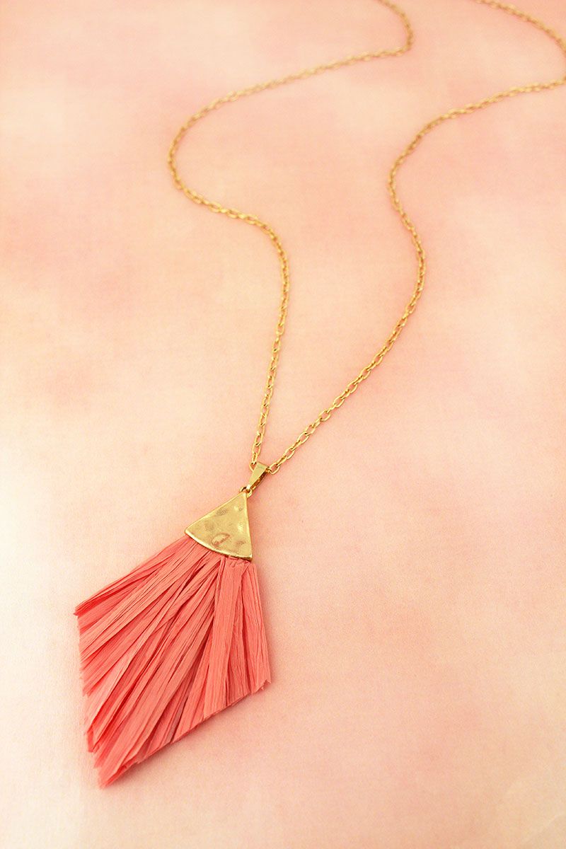 Crave Goldtone and Pink Raffia Pendant Necklace