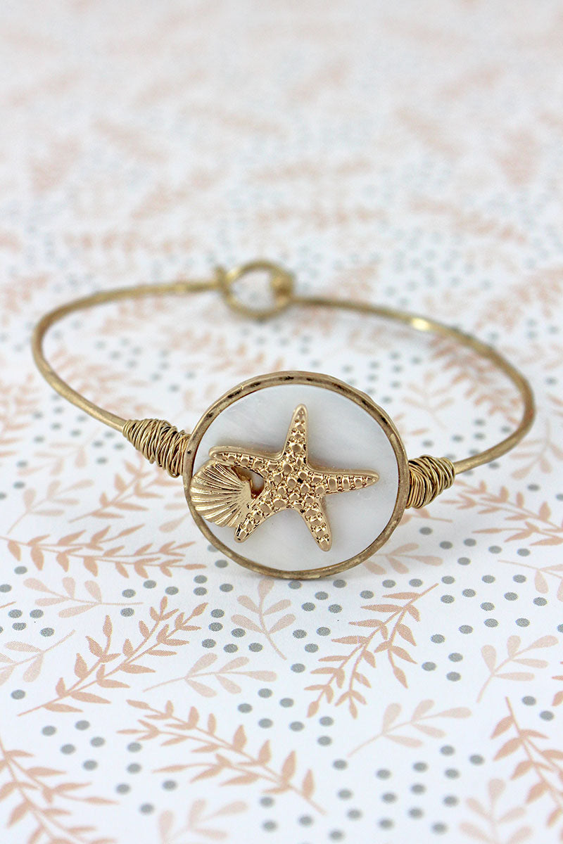 Crave Goldtone and Mother of Pearl Starfish Disk Bangle