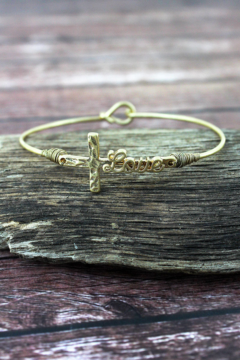 Crave Worn Goldtone 'Love' Script Cross Bangle